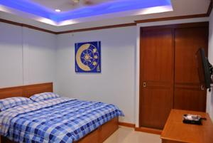 Une Des Chambres Confortable